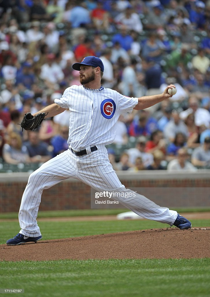 Travis Wood #37 of the Chicago Cubs pitches against the Houston Astros during the first inning on June 22, 2013 at Wrigley Field in Chicago, Illinois.