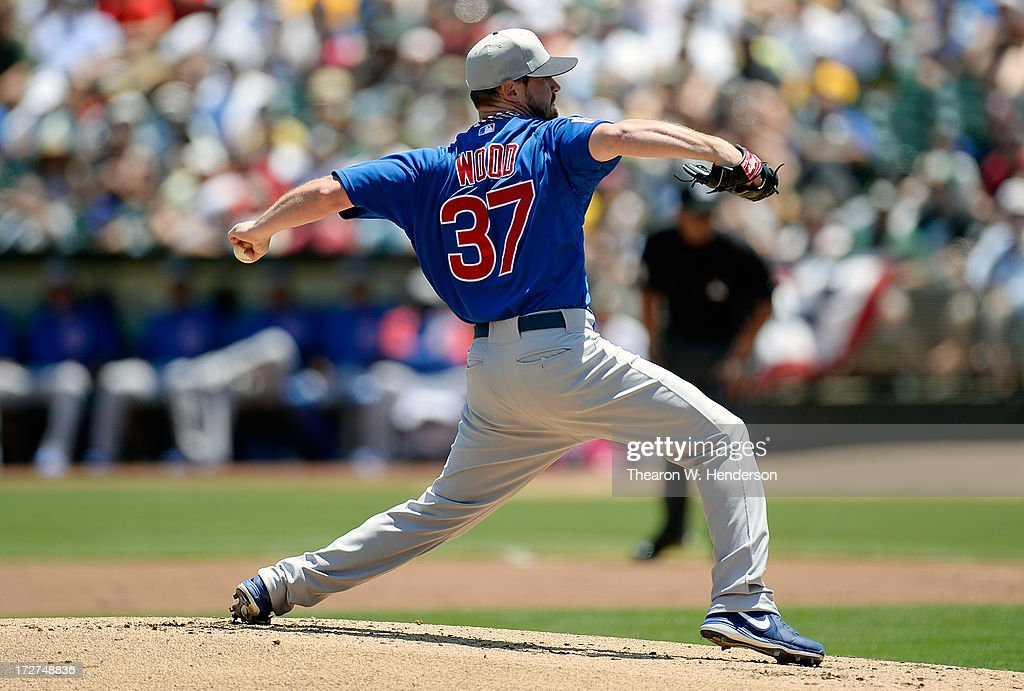 Travis Wood #37 of the Chicago Cubs pitches against the Oakland Athletics at O.co Coliseum on July 4, 2013 in Oakland, California.