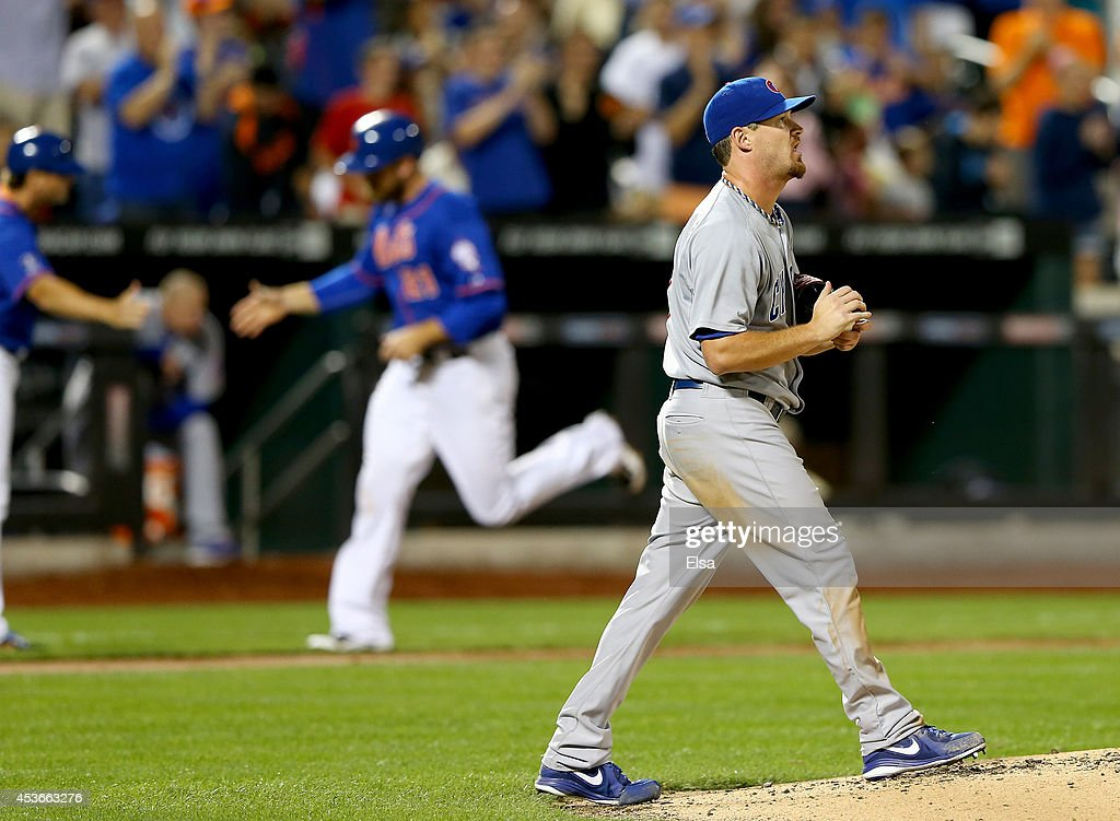 <a gi-track='captionPersonalityLinkClicked' href=/galleries/search?phrase=Travis+Wood&family=editorial&specificpeople=805314 ng-click='$event.stopPropagation()'>Travis Wood</a> #37 of the Chicago Cubs reacts after Eric Campbell of the New York Mets hit a three run homer in the fourth inning on August 15, 2014 at Citi Field in the Flushing neighborhood of the Queens borough of New York City.Lucas Duda of the New York Mets rounds third base.