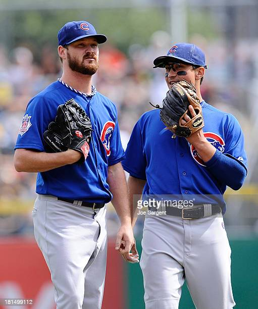 Travis Wood of the Chicago Cubs talks with Darwin Barney during the game against the Pittsburgh Pirates on September 15 2013 at PNC Park in...