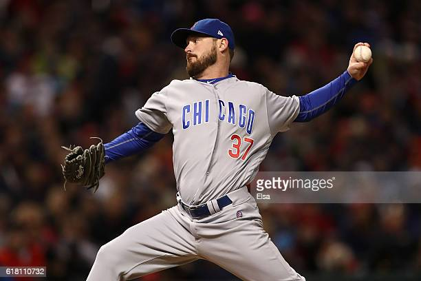 Travis Wood of the Chicago Cubs throws a pitch during the seventh inning against the Cleveland Indians in Game One of the 2016 World Series at...