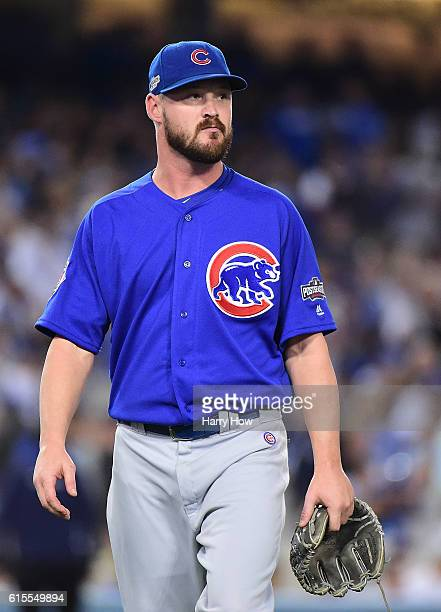 Travis Wood of the Chicago Cubs walks off the mound after being taken out of the game against the Los Angeles Dodgers in the sixth inning of game...