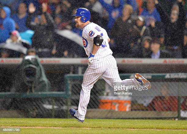 Travis Wood of the Chicago Cubs watches his threerun home run as he runs up the first base line during the second inning against the Arizona...