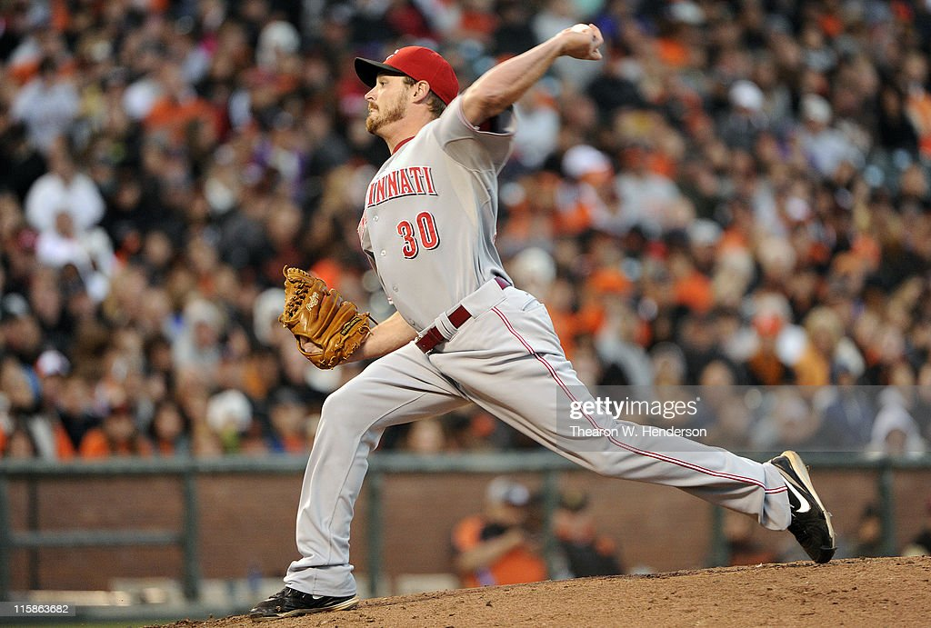 <a gi-track='captionPersonalityLinkClicked' href=/galleries/search?phrase=Travis+Wood&family=editorial&specificpeople=805314 ng-click='$event.stopPropagation()'>Travis Wood</a> #30 of the Cincinnati Reds pitches against the San Francisco Giants in the third inning during a MLB baseball game June 10, 2011 at AT&T Park in San Francisco, California.