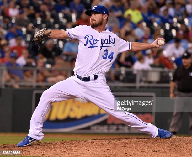 Travis Wood of the Kansas City Royals throw in the eighth inning against the Boston Red Sox at Kauffman Stadium on June 20 2017 in Kansas City...