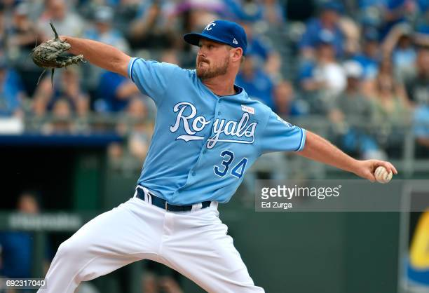 Travis Wood of the Kansas City Royals throws in the third inning against the Cleveland Indians at Kauffman Stadium on June 4 2017 in Kansas City...