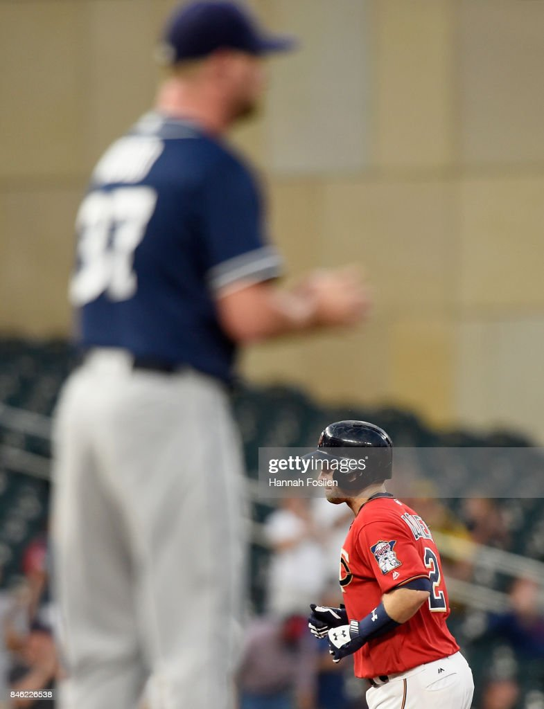 Travis Wood #37 of the San Diego Padres reacts as Brian Dozier #2 of the Minnesota Twins rounds the bases after hitting a solo home run during the first inning of the game on September 12, 2017 at Target Field in Minneapolis, Minnesota.