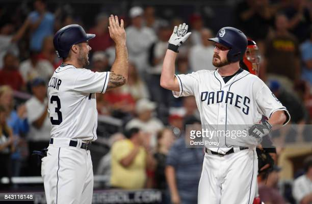 Travis Wood of the San Diego Padres right is congratulated by Matt Szczur of the San Diego Padres after hitting a tworun home run during the second...