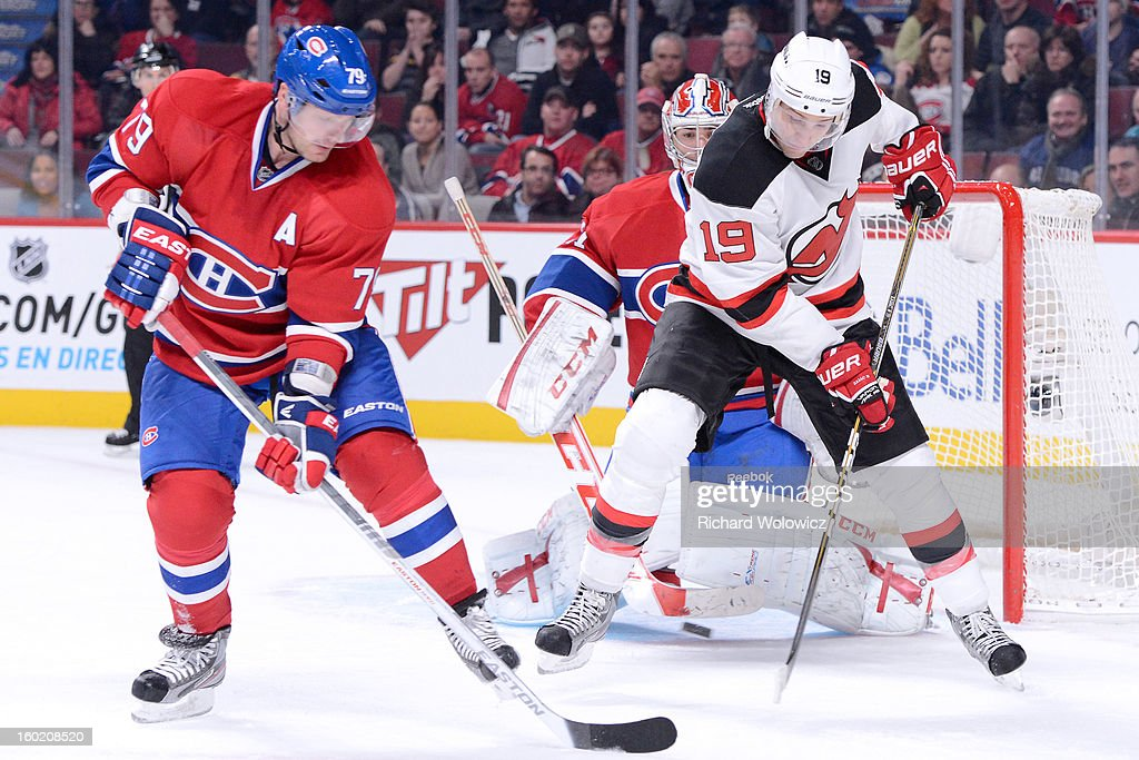 Travis Zajac #19 of the New Jersey Devils attempts to deflect the puck in front of Carey Price #31 of the Montreal Canadiens during the NHL game at the Bell Centre on January 27, 2013 in Montreal, Quebec, Canada. The Canadiens defeated the Devils 4-3 in overtime.