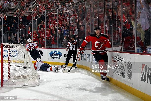 Travis Zajac of the New Jersey Devils celebrates after he scored the gamewinning goal in overtime against the Florida Panthers in Game Six of the...