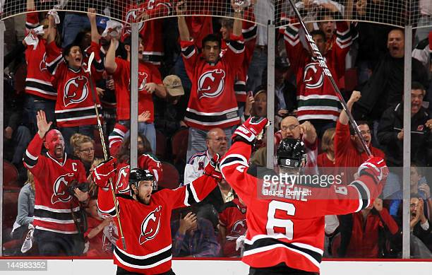 Travis Zajac of the New Jersey Devils celebrates his first period goal with Andy Greene of the New Jersey Devils in Game Four of the Eastern...