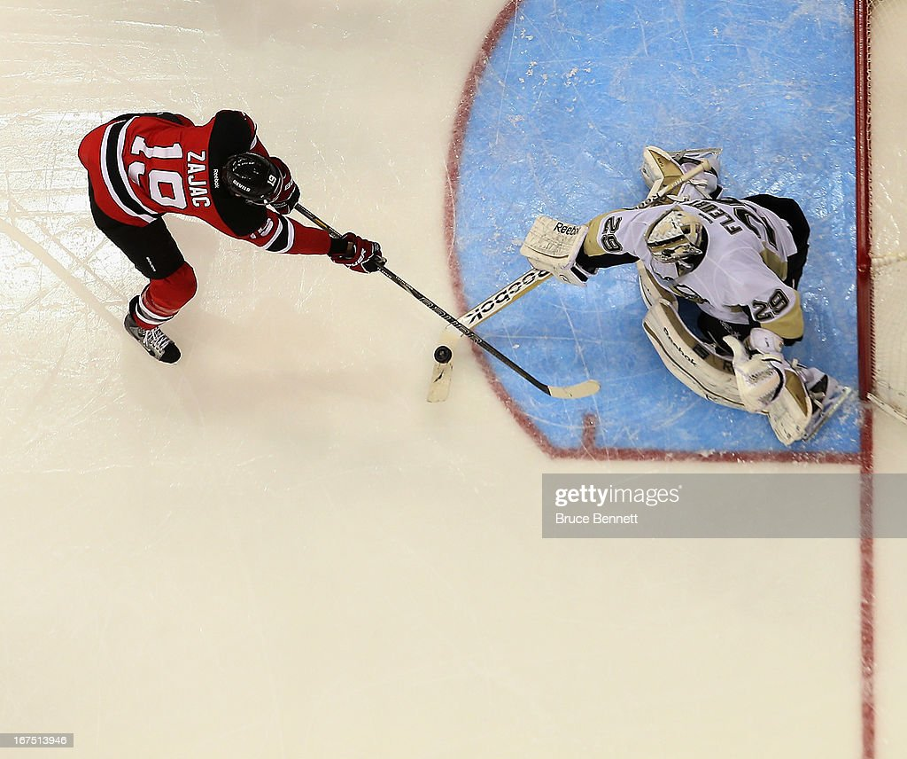 <a gi-track='captionPersonalityLinkClicked' href=/galleries/search?phrase=Travis+Zajac&family=editorial&specificpeople=864182 ng-click='$event.stopPropagation()'>Travis Zajac</a> #19 of the New Jersey Devils is stopped by <a gi-track='captionPersonalityLinkClicked' href=/galleries/search?phrase=Marc-Andre+Fleury&family=editorial&specificpeople=233779 ng-click='$event.stopPropagation()'>Marc-Andre Fleury</a> #29 of the Pittsburgh Penguins at the Prudential Center on April 25, 2013 in Newark, New Jersey. The Devils defeated the Penguins 3-2.
