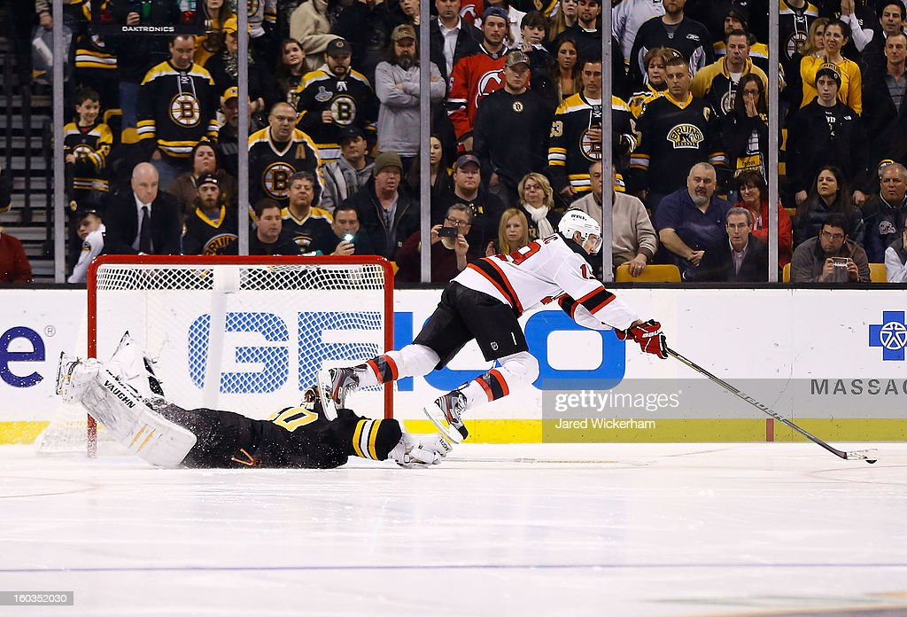 Travis Zajac #19 of the New Jersey Devils is tripped by Tuukka Rask #40 of the Boston Bruins on a shootout attempt during the game on January 29, 2013 at TD Garden in Boston, Massachusetts.