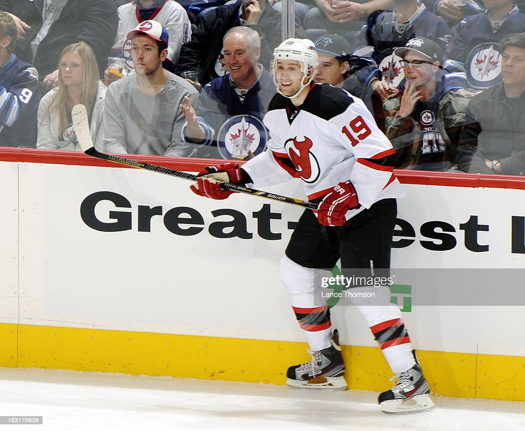Travis Zajac #19 of the New Jersey Devils keeps an eye on the play during second-period action against the Winnipeg Jets at the MTS Centre on February 28, 2013 in Winnipeg, Manitoba, Canada. The Jets defeated the Devils 3-1.