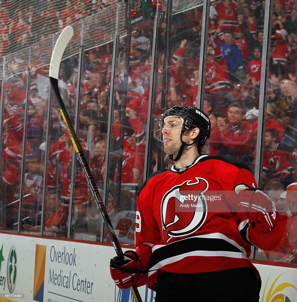 Travis Zajac #19 of the New Jersey Devils reacts after scoring a first period goal against Philadelphia Flyers during the game at the Prudential Center on February 15, 2013 in Newark, New Jersey.