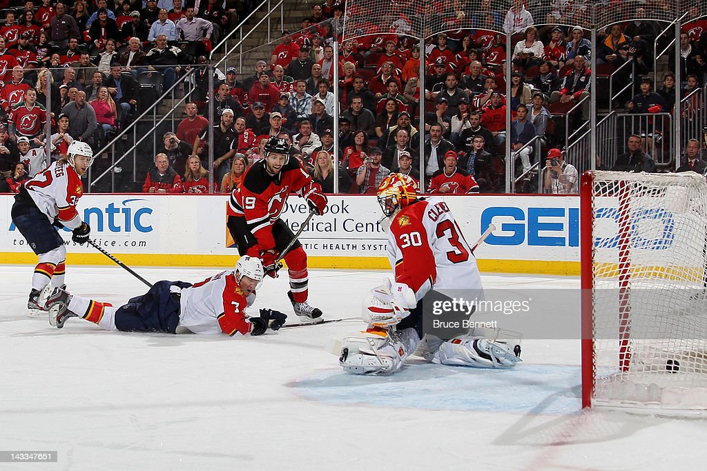 Travis Zajac of the New Jersey Devils scores the gamewinning goal in overtime against goalie Scott Clemmensen of the Florida Panthers in Game Six of...