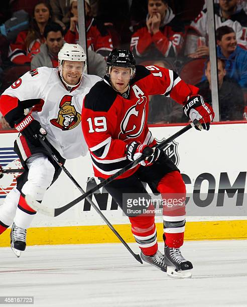 Travis Zajac of the New Jersey Devils skates against the Ottawa Senators at the Prudential Center on December 18 2013 in Newark New Jersey The Devils...