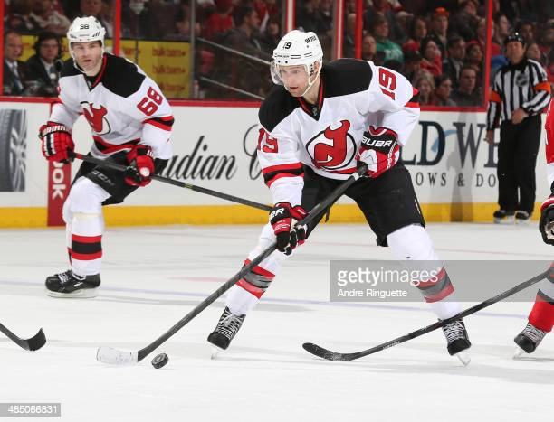 Travis Zajac of the New Jersey Devils skates against the Ottawa Senators at Canadian Tire Centre on April 10 2014 in Ottawa Ontario Canada