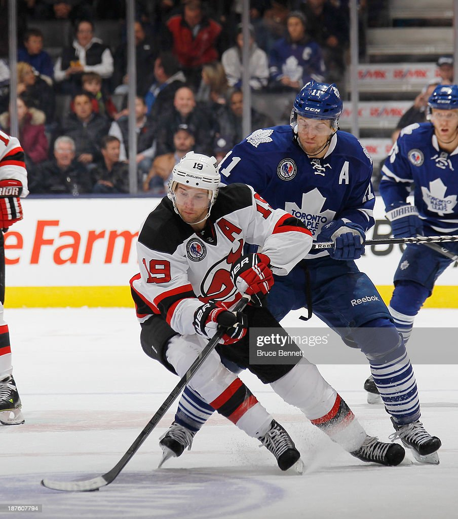<a gi-track='captionPersonalityLinkClicked' href=/galleries/search?phrase=Travis+Zajac&family=editorial&specificpeople=864182 ng-click='$event.stopPropagation()'>Travis Zajac</a> #19 of the New Jersey Devils skates against the Toronto Maple Leafs at the Air Canada Centre on November 8, 2013 in Toronto, Canada. The Maple Leafs defeated the Devils 2-1 in the shootout.