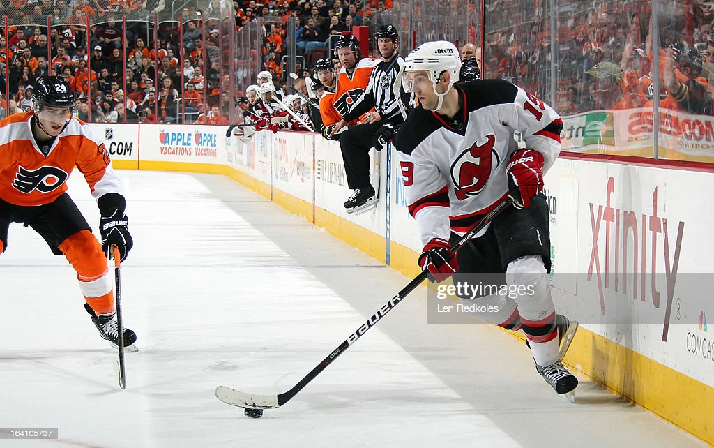 Travis Zajac #19 of the New Jersey Devils skates the puck against Matt Read #24 of the Philadelphia Flyers on March 15, 2013 at the Wells Fargo Center in Philadelphia, Pennsylvania.