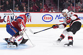 Travis Zajac of the New Jersey Devils takes a shot on goal Mike Condon the Montreal Canadiens in the NHL game at the Bell Centre on January 6 2015 in...