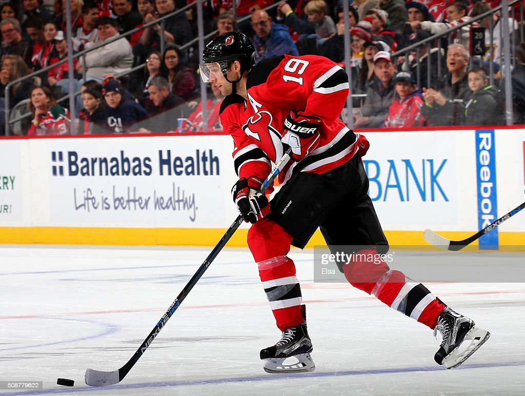 <a gi-track='captionPersonalityLinkClicked' href=/galleries/search?phrase=Travis+Zajac&family=editorial&specificpeople=864182 ng-click='$event.stopPropagation()'>Travis Zajac</a> #19 of the New Jersey Devils takes the puck in the third period against the Washington Capitals on February 6, 2016 at Prudential Center in Newark, New Jersey.The Washington Capitals defeated the New Jersey Devils 3-2 in an overtime shootout.