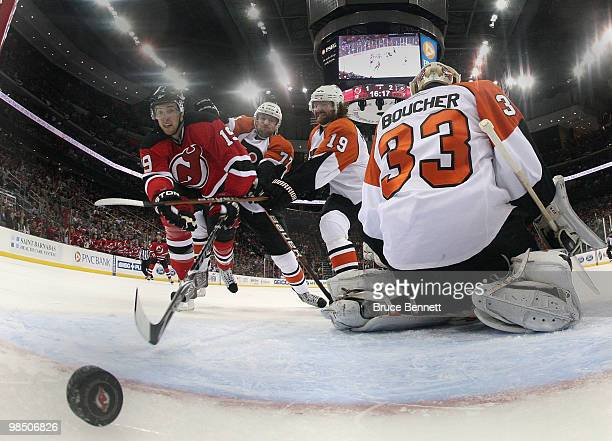 Travis Zajac of the New Jersey Devils watches a shot by Colin White go in the net in the second period against the Philadelphia Flyers in Game Two of...