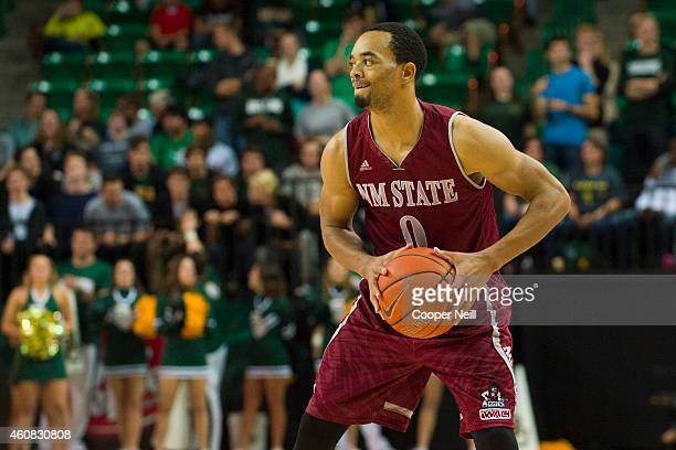 Travon Landry of the New Mexico State Aggies brings the ball up court against the Baylor Bears on December 17 2014 at the Ferrell Center in Waco Texas