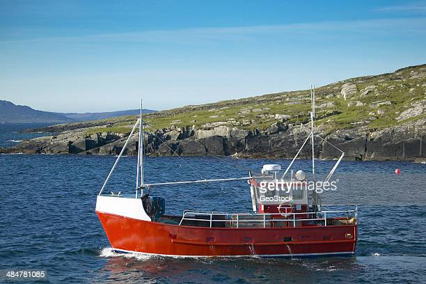 A trawler heads out to sea