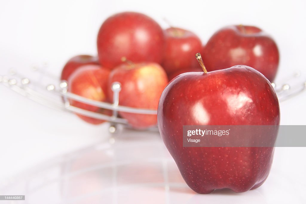 Tray full of Apples with one Apple set apart : Stock Photo