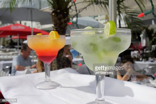 A tray holding two cocktails at a restaurant on New Year's Day on Ocean Drive