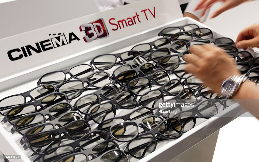 A tray of 3-D glasses stand at the LG Electronics Inc. booth at the Tokyo Game Show 2012 at Makuhari Messe in Chiba, Japan, on Thursday, Sept. 20, 2012. The show will be held through Sept. 23. Photographer: Tomohiro Ohsumi/Bloomberg via Getty Images