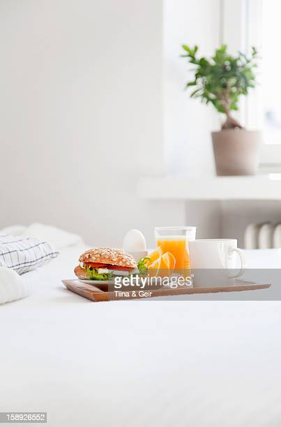 Tray of breakfast food on bed