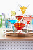 Tray of cocktails on bar