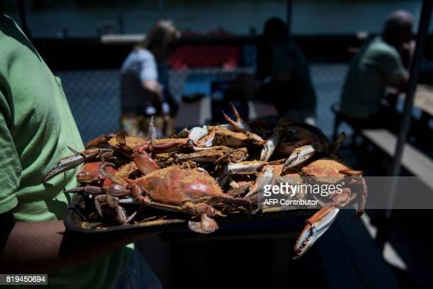 A tray of crabs are brought to customers at Cantler's Riverside Inn June 28 2017 in Annapolis Maryland A unique multimillion dollar industry crab...