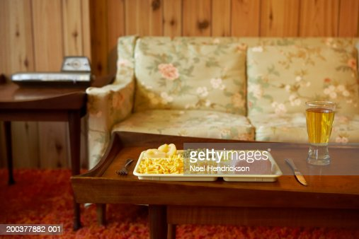 Tray of food and beverage on coffee table