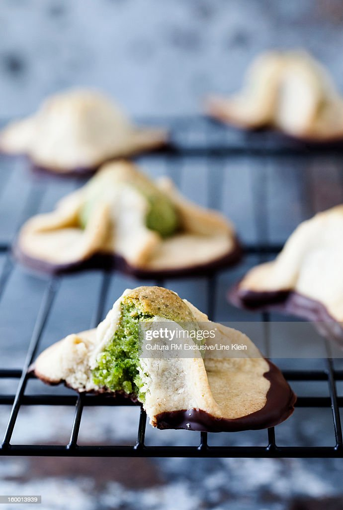 Tray of marzipan and pistachio pastries : Stock Photo