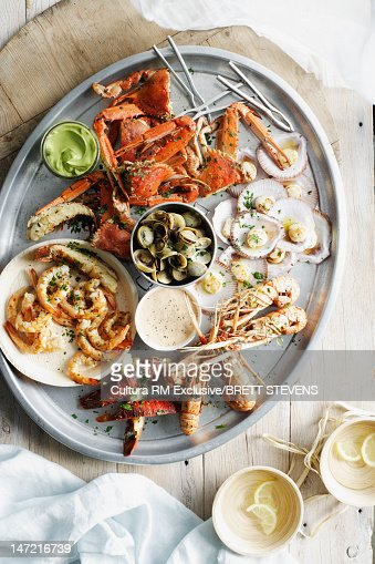 Tray of seafood with dipping sauces