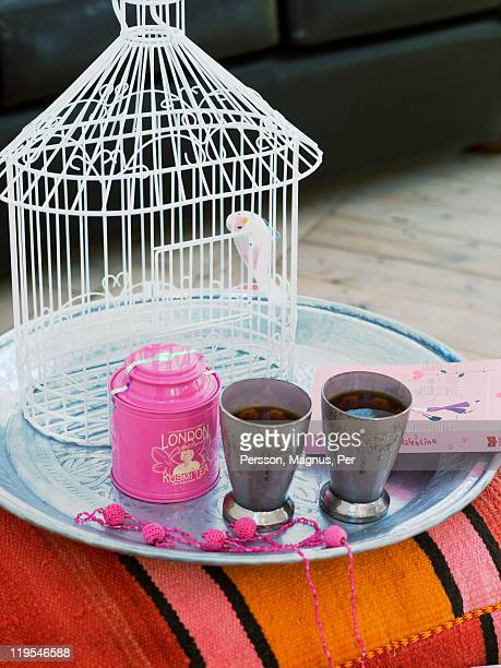 Tray with birdcage and cups