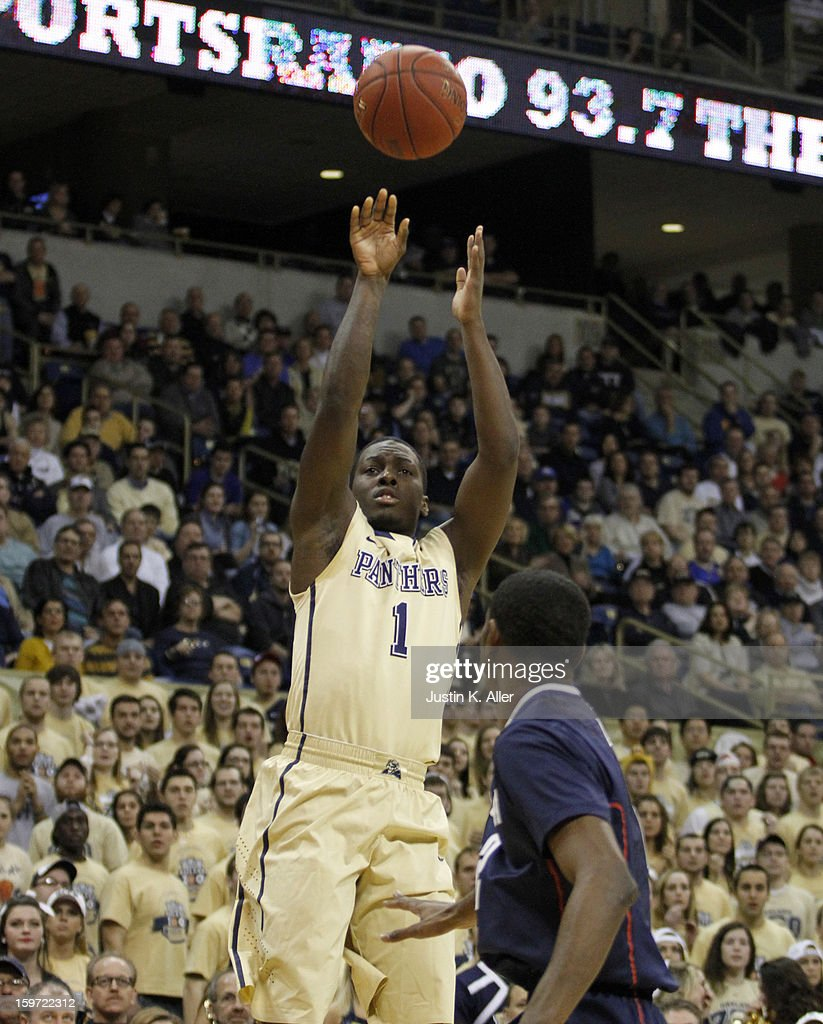 Tray Woodall #1 of the Pittsburgh Panthers pulls up for a shot against the Connecticut Huskies at Petersen Events Center on January 19, 2013 in Pittsburgh, Pennsylvania.