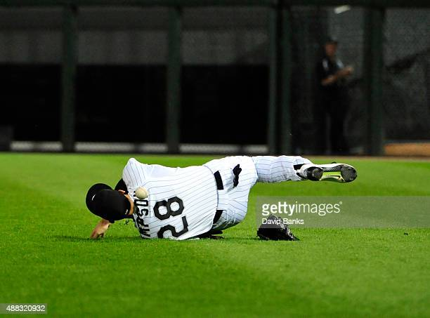 Trayce Thompson of the Chicago White Sox can't catch a double hit by Brett Lawrie of the Oakland Athletics during the ninth inning on September 14...