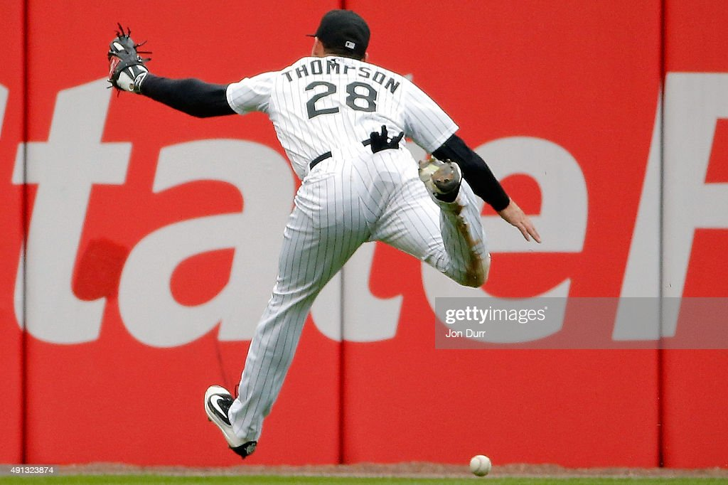 Trayce Thompson #28 of the Chicago White Sox is unable to make a catch against the Detroit Tigers during the fifth inning at U.S. Cellular Field on October 4, 2015 in Chicago, Illinois.