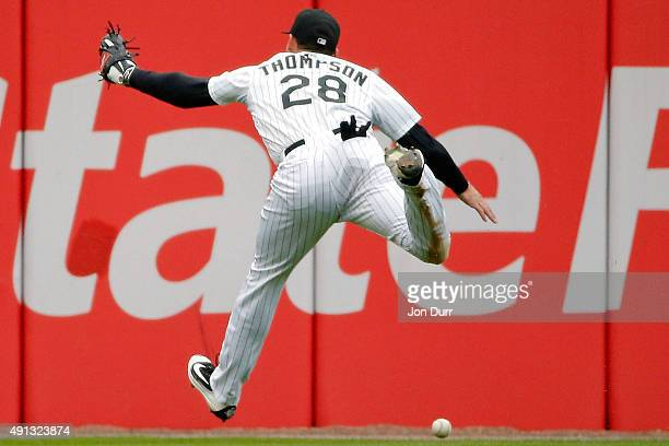 Trayce Thompson of the Chicago White Sox is unable to make a catch against the Detroit Tigers during the fifth inning at US Cellular Field on October...