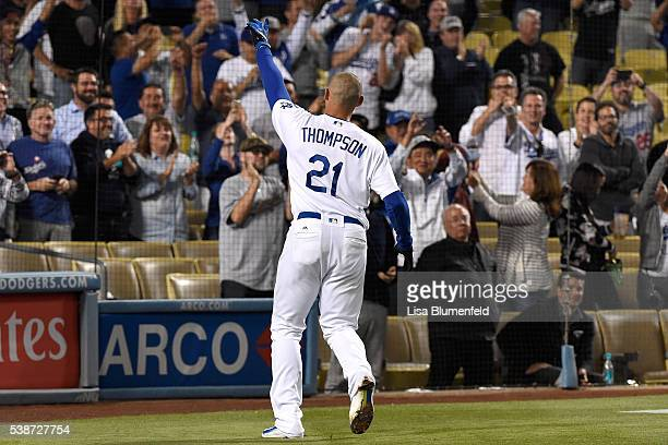Trayce Thompson of the Los Angeles Dodgers acknowledges the crowd after hitting a walk off homerun to defeat the Colorado Rockies 43 at Dodger...
