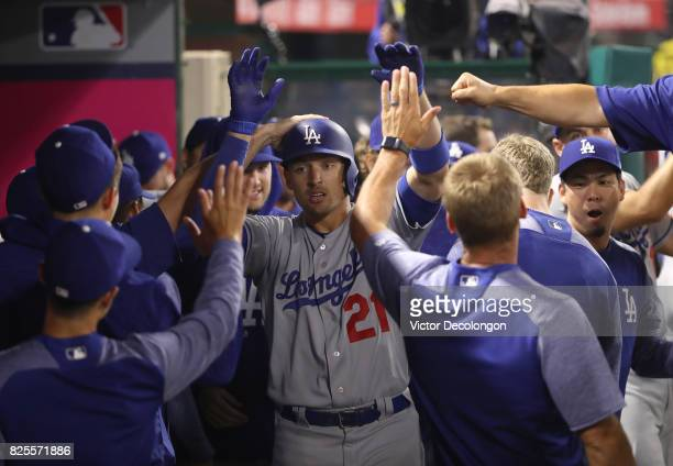 Trayce Thompson of the Los Angeles Dodgers celebrates his solo homerun in the dugout with teammates in the eighth inning during the MLB game against...