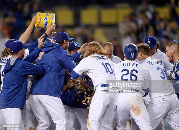 Trayce Thompson of the Los Angeles Dodgers is mobbed by his teammates after hitting the game winning pinch hit onerun home run to defeat the New York...