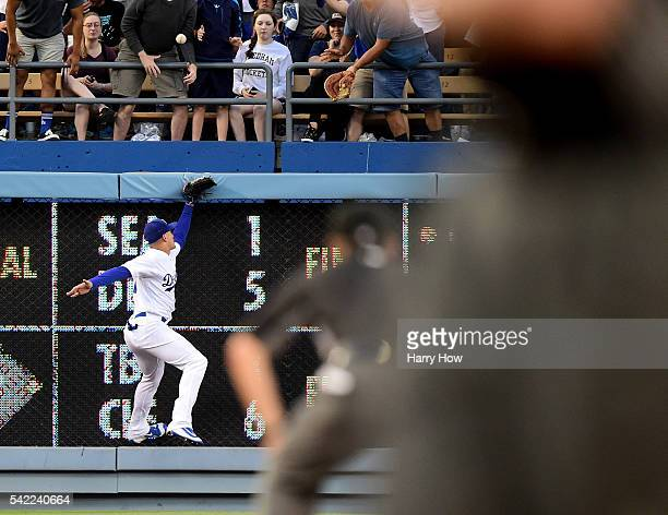 Trayce Thompson of the Los Angeles Dodgers misses a catch off the bat of Danny Espinosa of the Washington Nationals for a double to score Ryan...