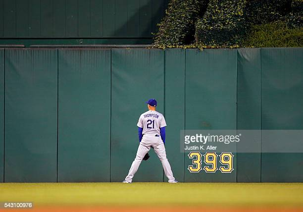 Trayce Thompson of the Los Angeles Dodgers reacts after watching a home run go over the wall in the sixth inning during the game against the...