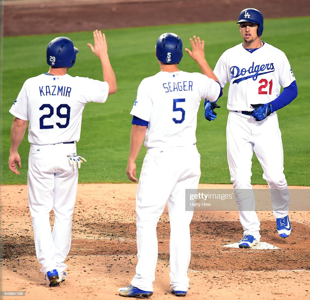 Trayce Thompson of the Los Angeles Dodgers reacts to his three run homerun with Scott Kazmir and Corey Seager to tie the game 33 with the Milwaukee...