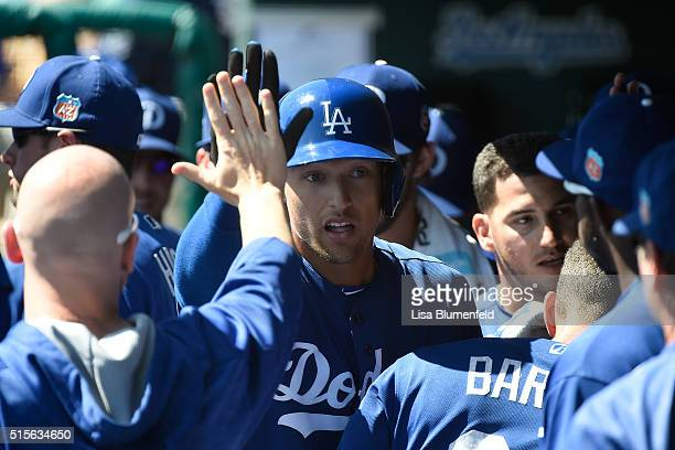 Trayce Thompson of the Los Angeles Dodgers returns to the dugout after hitting a threerun home run in the first inning against the Milwaukee Brewers...